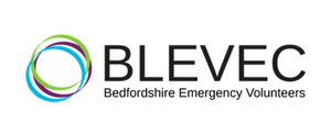 Logo of the Bedfordshire Local Resilience Forum. Contains the slogan 'Working together in an emergency', and a design of five concentric,  three-quarter circles round a white centre.